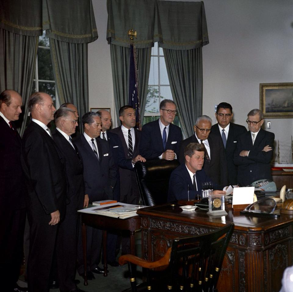 1962 Pres Kennedy signs SJCP into law