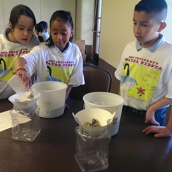 Buckman Direct Diversion teaches 4th graders about water filtration with hands-on experiments at the Santa Fe Water Conservation's 2015 Children's Water Fiesta